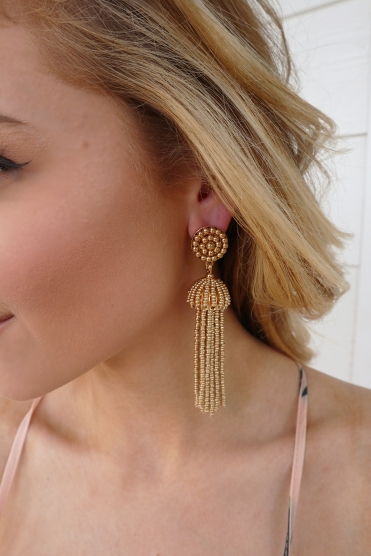 gold earrings close up